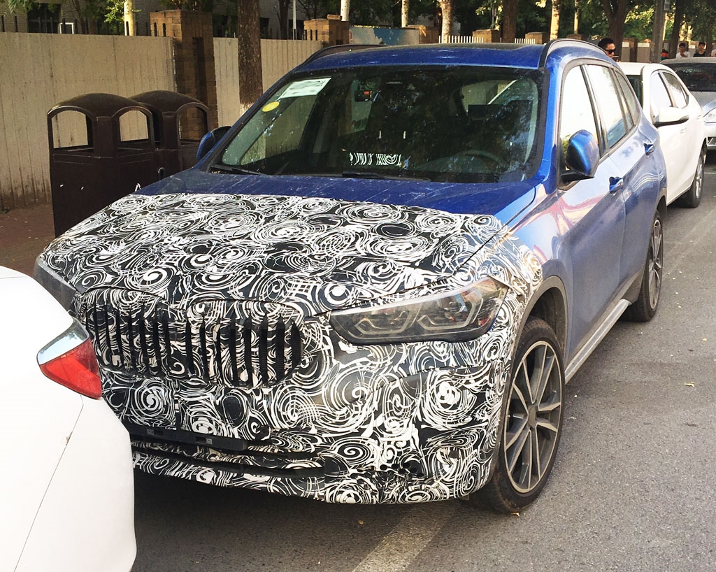Name:  2019-BMW-X1-facelift-front-three-quarters-spy-shot.jpg